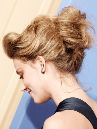 BEVERLY HILLS, CA - JANUARY 12: Actress Amber Heard (hair detail) poses in the press room during the 71st Annual Golden Globe Awards held at The Beverly Hilton Hotel on January 12, 2014 in Beverly Hills, California. (Photo by Kevin Winter/Getty Images)